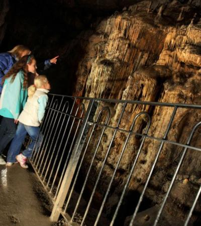 Family exploring Poole's Cavern in Buxton