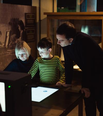 Family reading at Bletchley Park in Milton Keynes