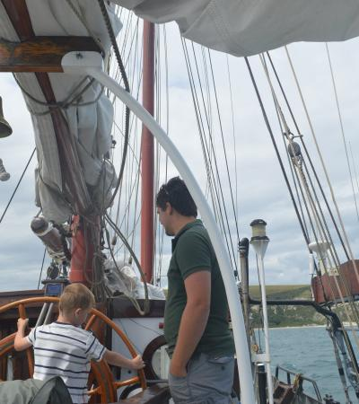 Dad and son on boat at Moonfleet Adventure Sailing in Isle of Portland