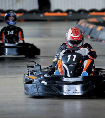 People go karting at Formula Fast Indoor Karting in Milton Keynes