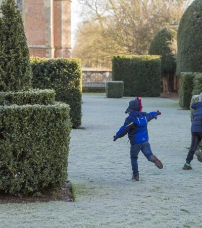Kids playing in the garden at Charlecote Park in Warwickshire