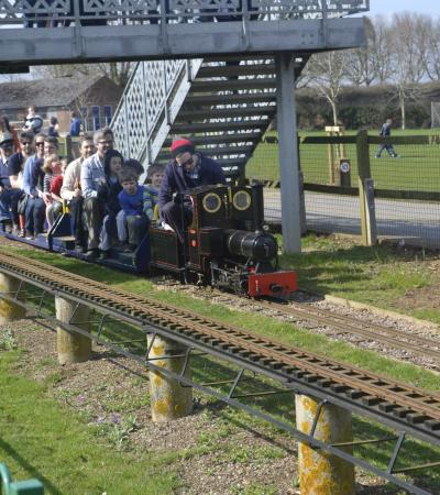 Families on train at Cutteslowe Park and Miniature Railway in Oxford