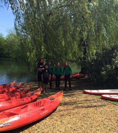 Girls canoeing in lake at Andover Leisure Centre