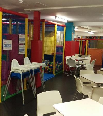 Indoor soft play frame and seating area at Rockys Fun House Brentwood