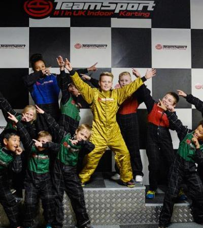Kids on podium at Teamsport Indoor Karting Basildon