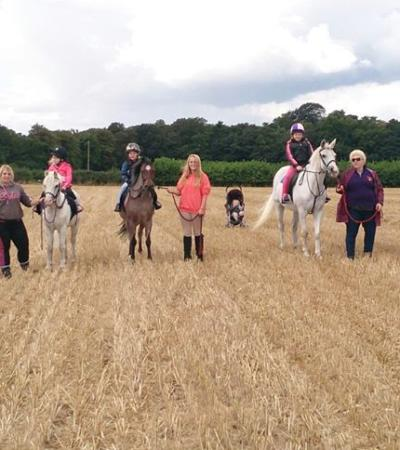 People trekking on horse riding at Willow Farm Riding School in Great Yarmouth