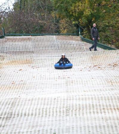 Person tubing at Telford Snowboard and Ski Centre