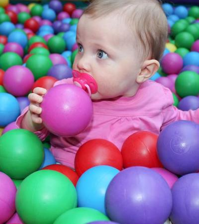 Baby in ball pit at Jungle Mania Play Centre Welwyn Garden City