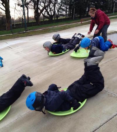 Kids sledding at Ski Rossendale in Rawtenstall
