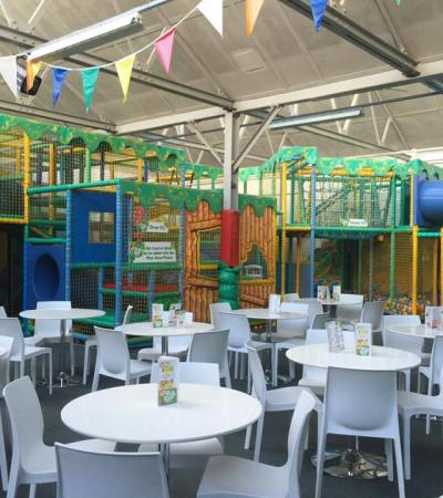 Indoor soft play frame and cafe area at DJ's Jungle Adventure Soft Play Centre in St Albans