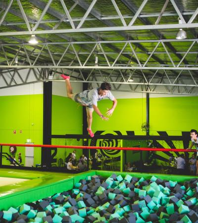 Boy jumping into foam pit at Flip Out Sandwell in Oldbury