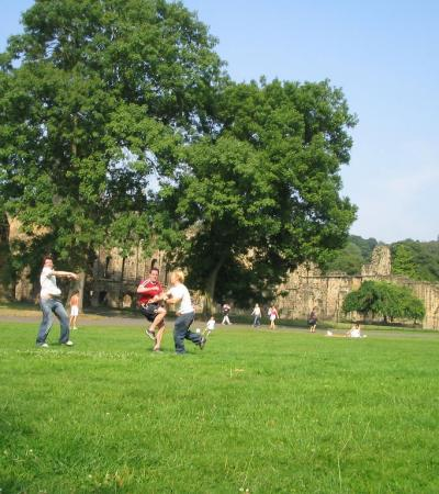 Kids playing by St Marys Abby at Abbey Fields Play Park in Kenilworth