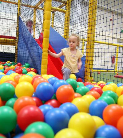 Girl in ball pit at Snakes and Ladders Dunstable