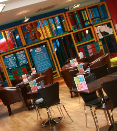 Indoor soft play frame and cafe area at Little Rascals Indoor Play Party Centre in Hitchin