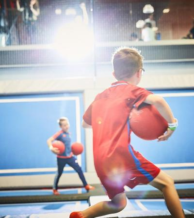 Kids playing dodgeball on trampolines at Air Space Stevenage