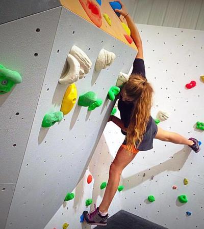 Girl climbing at Rockstar Climbing in Swindon