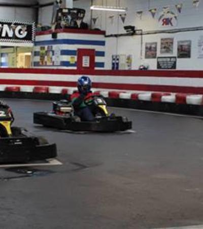 People go kart racing at Rayleigh Indoor Karting Stadium