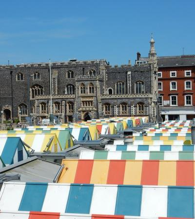 Market stalls by Guildhall in Curious About Norwich tour