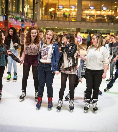People ice skating at National Ice Centre in Nottingham
