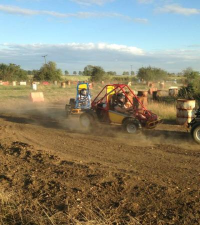 Racers speed on dirt track at Rally Karting in Huntingdon