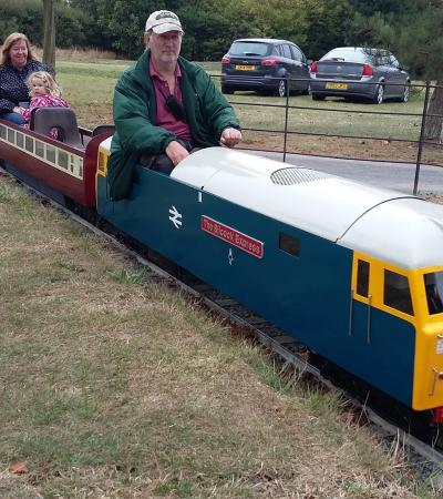 People on mini train at Barnards Miniature Railway in West Horndon