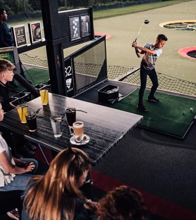 Family golfing at Topgolf Chigwell