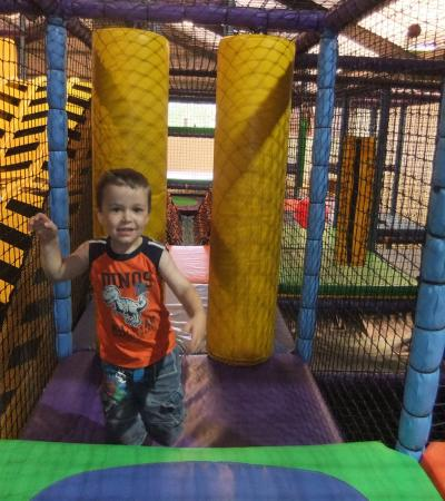 Boy on soft play frame at Manic Monsters in Edenbridge