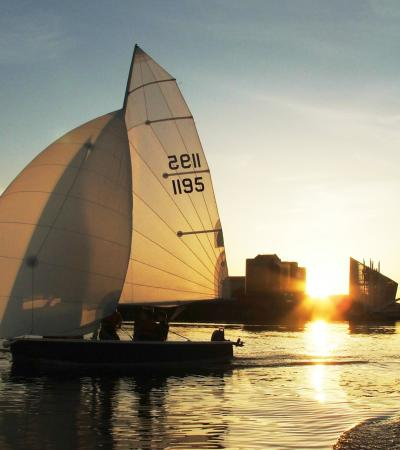 People sailing at Helly Hansen Watersports Centre in Salford