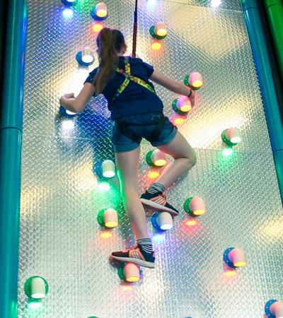 Girl climbing at Clip n Climb Nottingham