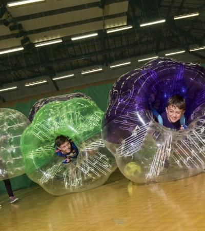 Kids playing zorb football at Colchester Leisure World