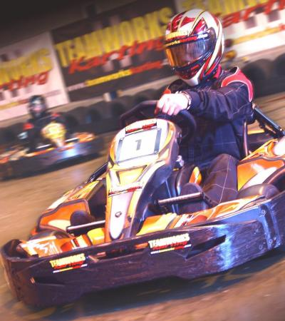Person go kart racing at Teamworks Karting Birmingham