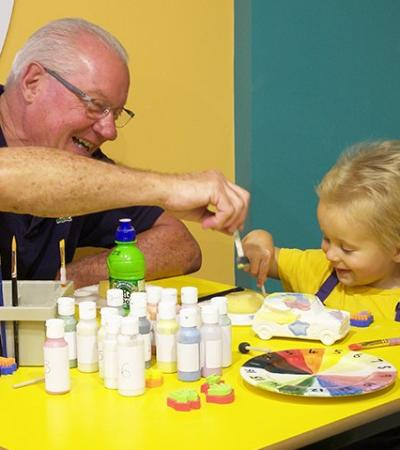 Granddad and grandson painting at The Paint Hub in Dawlish Warren