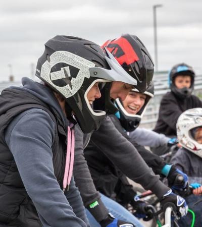 Family cycling at Cyclopark in Gravesend