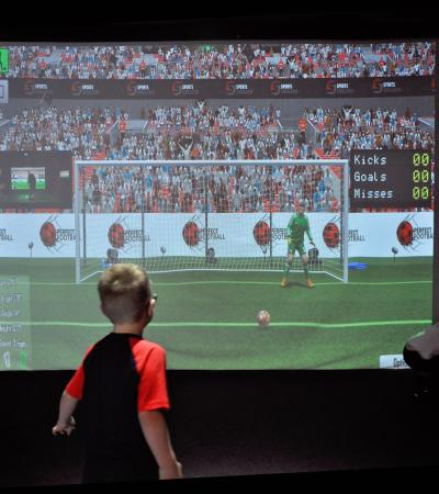 Boy playing football on VR at The Bunker Indoor Golf & Multi-Sport Centre in Newton Abbot