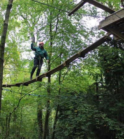 Person on high rope course at Brokerswood Country Park in Westbury