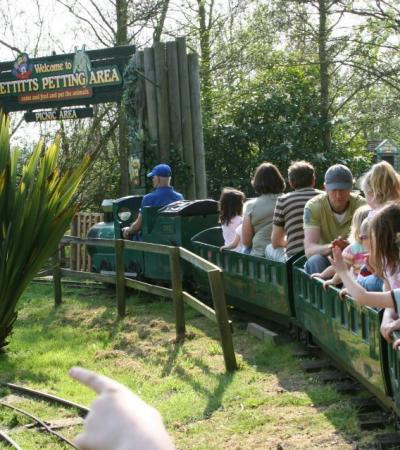 Families on miniature train at Pettitts Adventure Park in Reedham