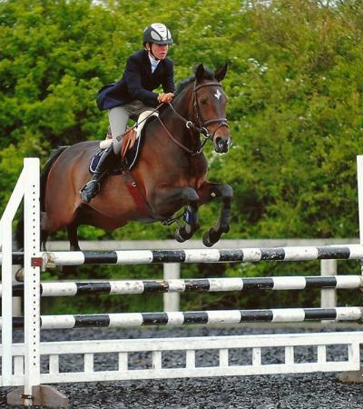 Rider and horse on course at Riding Farm Equestrian Centre in Hildenborough