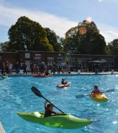 Kids on mini kayaks at Brockwell Lido in Lambeth