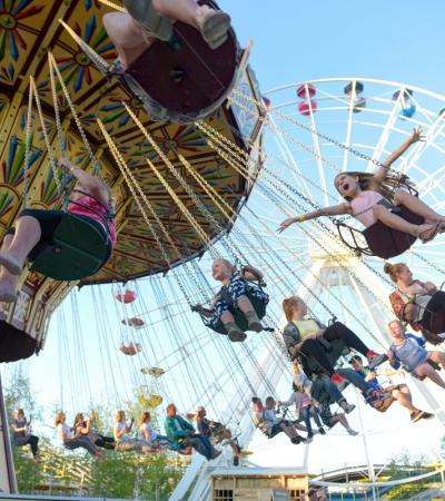 Kids on swings at Dreamland in Margate