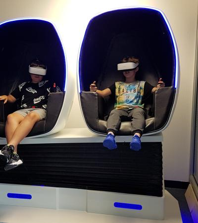 Kids in the VR simulating chairs at VR HAPPY