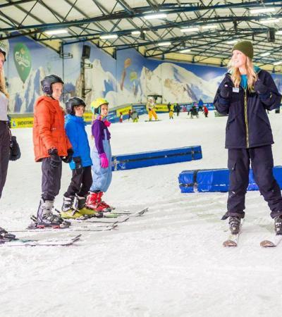 Instructor teaching family to ski at Tamworth Snowdome