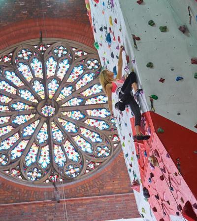 Girl on climbing wall at Manchester Climbing Centre