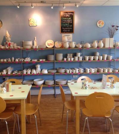 Seating area and pottery items at Pot N Kettle Ceramic Cafe in Beeston