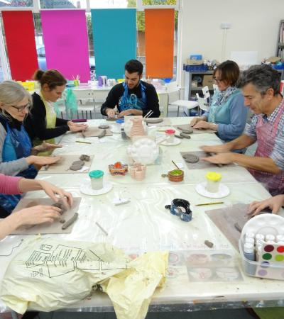 Adults crafting at Hands-on Art Adventures in Windsor