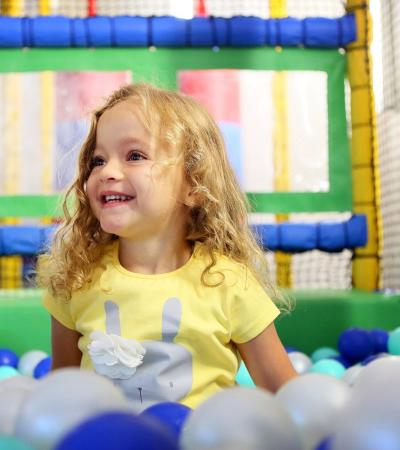 Girl in ball pit at The Play Centre at Edmonton Leisure