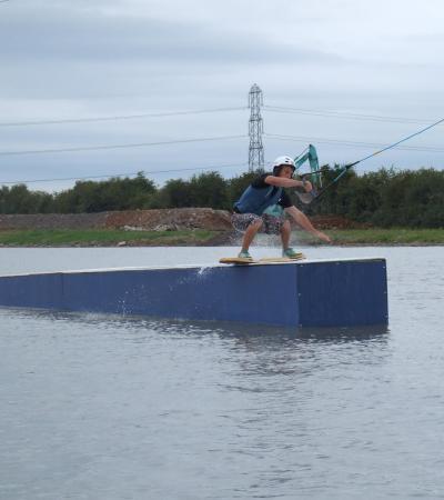 Man wakeboarding at Middlemoor Water Park in Woolavington
