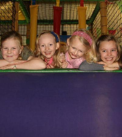 Girls on soft play slide at Jangala in Derby