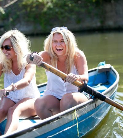 Women rowing boat from Lee Valley Boat Centre in Broxbourne