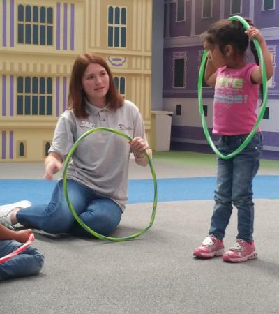 Girls hula hooping at Under 1 Roof Kids in London