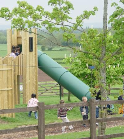 Kids playing on adventure playground at Court Farm Country Park in Weston Super Mare